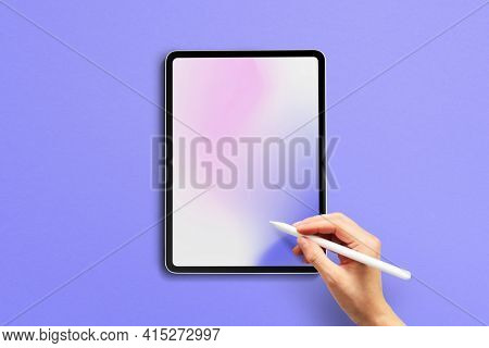 Tablet screen with design space hand holding stylus