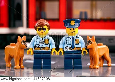 Tambov, Russian Federation - March 03, 2021 Two Lego Police Officers With Dogs Standing On The Platf