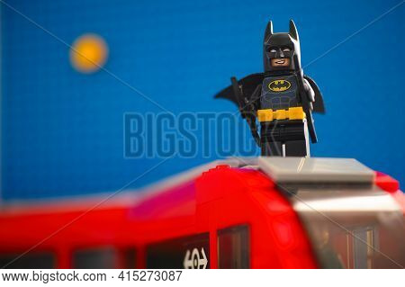 Tambov, Russian Federation - March 03, 2021 Lego Batman On The Top Of Train Against Blue Background