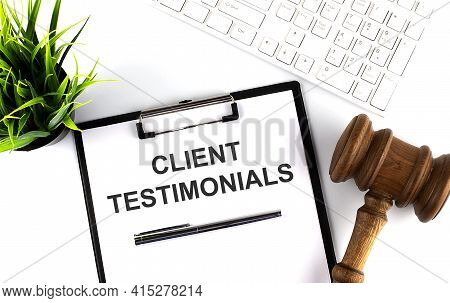 White Office Desk Table With Blank Sheet With Text Client Testimonials , Keyboard And Gavel,