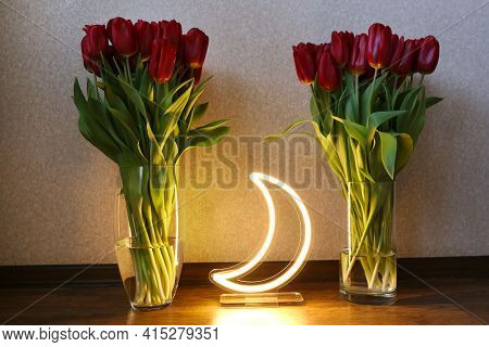 Neon Moon Sign With Beautiful Red Tulips. Trendy Style. Floral Background.neon Sign. Custom Neon. Ho