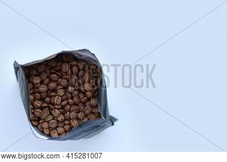 Packaged Freshly Roasted Coffee Beans.coffee In A Bag.a Bundle Of Coffee Beans On A White Background