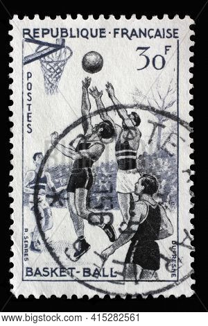 ZAGREB, CROATIA - SEPTEMBER 09, 2014: Stamp printed in the France shows Basketball, Gordon Bennett Cup series, circa 1956