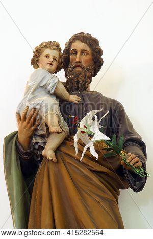 MIHOVLJAN, CROATIA - JULY 15, 2013: St. Joseph holds baby Jesus, statue in the parish church of St. Michael the Archangel in Mihovljan, Croatia