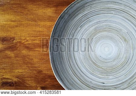 Round Wooden Plate On Table. Food Background. Empty Round Plate For Food Background. Food Background