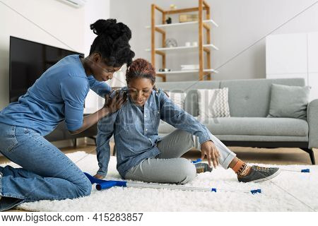 Slip And Fall Risk. Helping African Woman