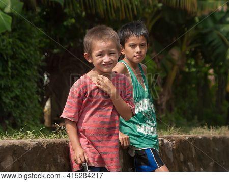 La Libertad, El Salvador. 11-18-2019. Portrait Of Two Boys Playing On The Street In La Libertad, El