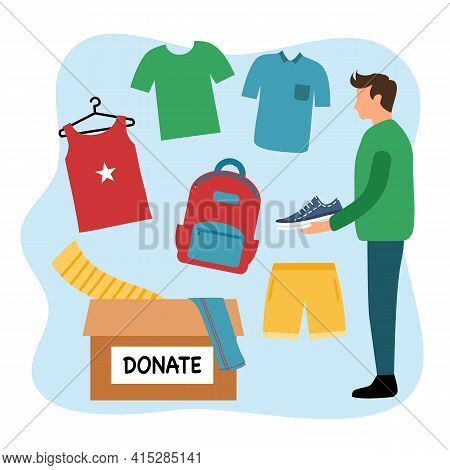 Sharing Clothes To People. Clothes Donation Concept. Man Standing With Donate Box Of Clothes And Acc