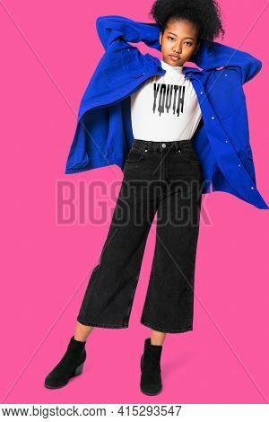 Girl in white t-shirt with YOUTH typography and jacket winter fashion shoot