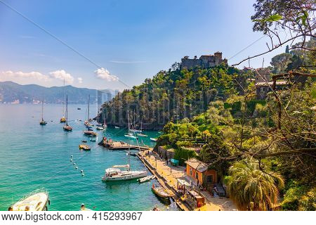 Beautiful Colorful View Gulf Of Portofino Italy With Castle Brown In Background And Boats Anchored T
