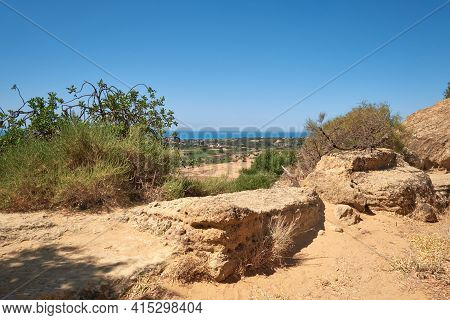 Ancient Protective Wall Of Akragas Town. Ancient Stones, Landscape With Olive Trees And View From Th