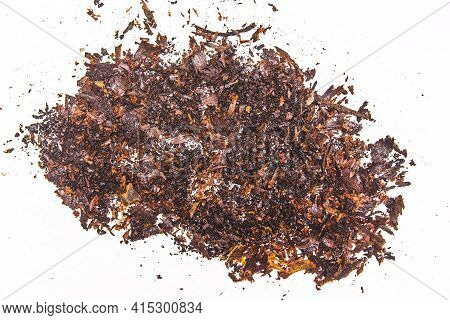 A Pile Of Rusty, Dirty Old Dark Soot From A Pan On A White Background.
