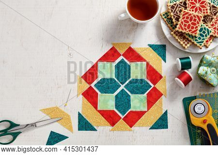 Pieces Of Fabric Laid Out In The Shape Of A Patchwork Block, A  Heap Of Cookies With A Pattern Imita