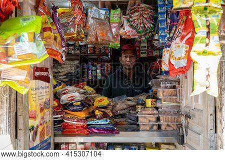 Vendor In His Shop