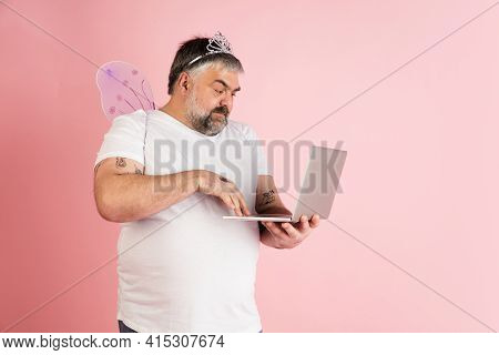 Handsome Caucasian Plus Size Male Model Isolated On Coral Pink Studio Background. Concept Of Inclusi