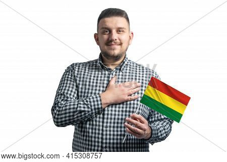 White Guy Holding A Flag Of Bolivia And Holds His Hand On His Heart Isolated On A White Background W
