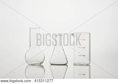 Collection Of Chemical Glassware In Laboratory On White Background. Test-tubes And Laboratory Glassw