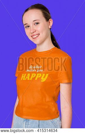 Teenage girl in orange tee printed with motivational quote youth apparel shoot