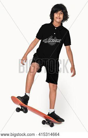 Teenage skater in black polo t-shirt sporty youth fashion studio shoot