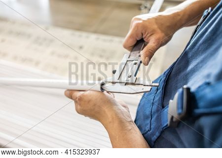 Factory Worker Engineer Checks The Quality Of Polypropylene Pipes