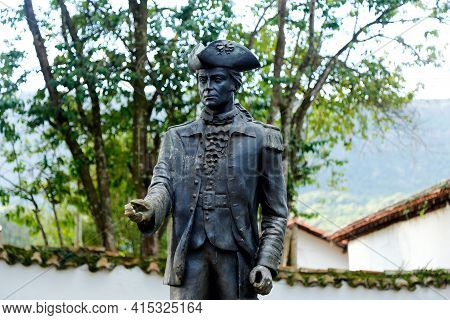Tiradentes, Minas Gerais, Brazil - February 20, 2021: Tiradentes Metal Statue Representing The Young