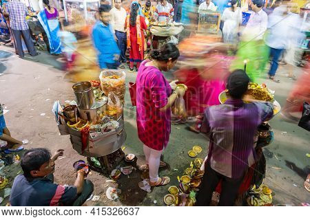 Howrah, West Bengal, India - April 14th 2019 : Hindu Bengali Devotees Eating Chotpoti , A Roadside I