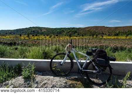 Cycling Travel. Cycling Tourism. Bikepacking. Bicycle With Trunks In The Background Of The Landscape