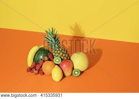 Pile Of Exotic Fruits Isolated On A Colored Background. Heap Of Fresh Organic Fruits Minimalist On A