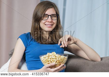 Portrait Of Happy Crying Sentimental Girl, Young Beautiful Woman In Glasses Watching Tv, Film Or Dra