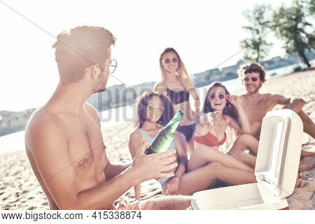 Enjoying Carefree Time With Friends. Cheerful Young People Spending Nice Time Together While Sitting