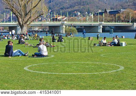 Heidelberg, Germany - April 2020: White Circles Painted On Meadow At Neckar Riverbank To Ensure Peop