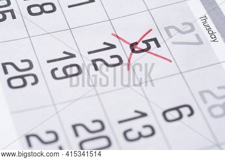 Red Cross Marked On Calendar Sheet. Mark On The Calendar At 5. Date Of Calendar.