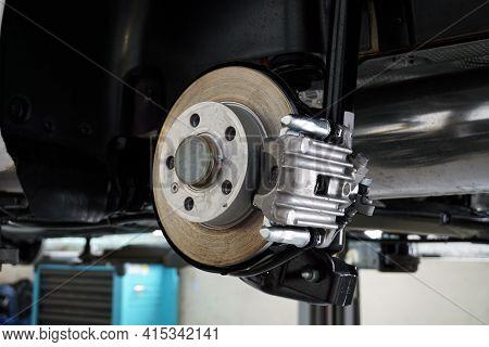 Disc Brakes Of A Modern Car. Brake Disc, Brake Caliper. Maintenance And Repair Of A Modern Car. Spar