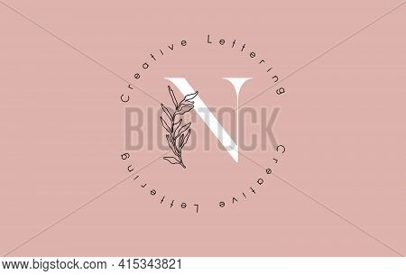 White Letter N Logo With Circle Lettering Design And Outline Leaves And Pastel Background. Creative