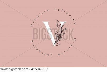 White Letter V Logo With Circle Lettering Design And Outline Leaves And Pastel Background. Creative