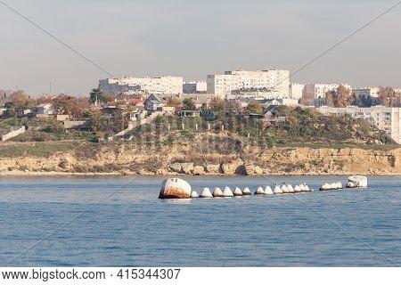 Sevastopol. Russia. Winter 2020. Raid Barrel In The Bay. A Large Metal Barrel For Mooring The Ship.