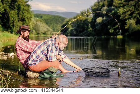 Fly Fish Hobby Of Men. Retirement Fishery. Two Male Friends Fishing Together. Big Game Fishing. Rela