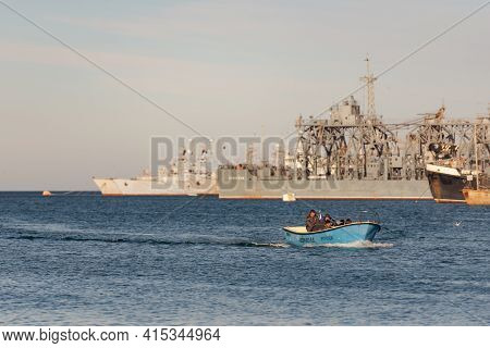 Sevastopol. Russia. Winter 2020. Fishermen On A Boat Return Home. Fishing Boat Returns To The Bay. B