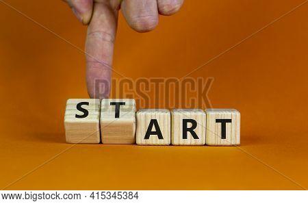 Start Art Symbol. Businessman Turns Cubes And Changes The Word 'start' To 'art'. Beautiful Orange Ta