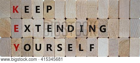 Key, Keep Extending Yourself Symbol. Wooden Blocks With Words 'key, Keep Extending Yourself'. Beauti
