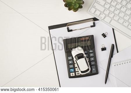 Top View Photo Of Business Workplace With Keyboard Notebook Pen Plant Papers Folder And Car Model On