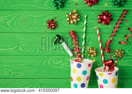 Top View Photo Of Birthday Composition Blast From Paper Dotted Cups Of Tinsel Sparkles Red Green Gol