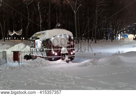 Samara, Russia-january 10, 2021. A Mobile Diner Covered In Snow In A Park Area In The Winter Season.