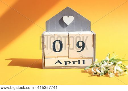 Calendar For April 9 : Cubes With The Numbers 0 And 8, The Name Of The Month Of April In English, A