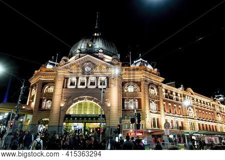 Melbourne, Australia - May 15, 2019: Lit Up Night View Of The Iconic Flinders Street Station. Street