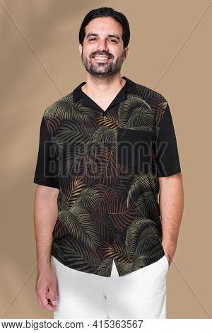 Indian man wearing black shirt with white shorts