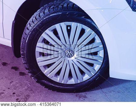 Novosibirsk, Russia - April 01 2021: Volkswagen Polo, Car Wheel On White   Car - Close Up   Under Pi