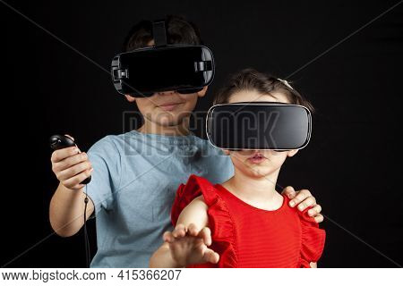 A Caucasian Boy And A Girl Wearing Virtual Reality Headsets Are Playing Multiplayer Game. A Futurist