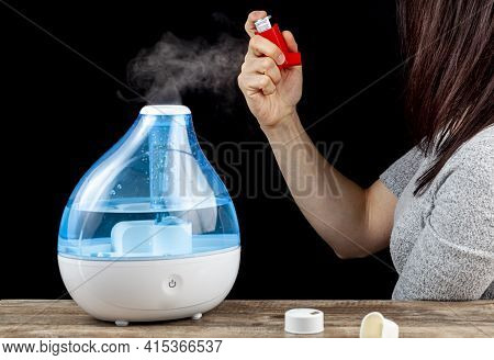 Asthma, Allergy Attack Concept With Ultrasonic Air Humidifier Creating Cool Mist And A Woman Holding