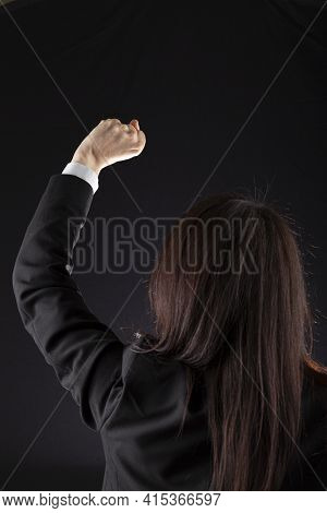 A Caucasian Business Woman Wearing Jacket And White Shirt Is Raising Left Fist For Victory Or Protes